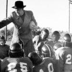Football Coach with team