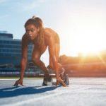 Female Sprinter in Starting Blocks